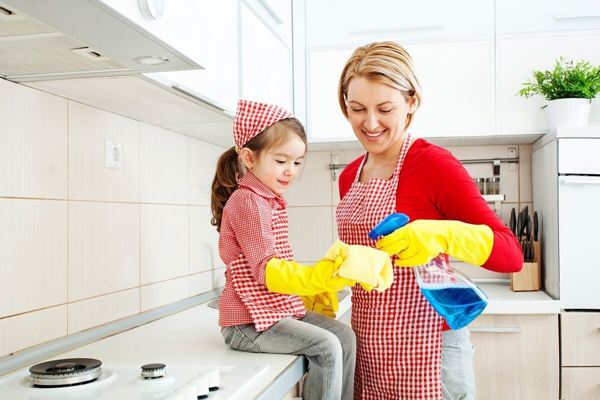 Mother and daughter cleaning a kitchen