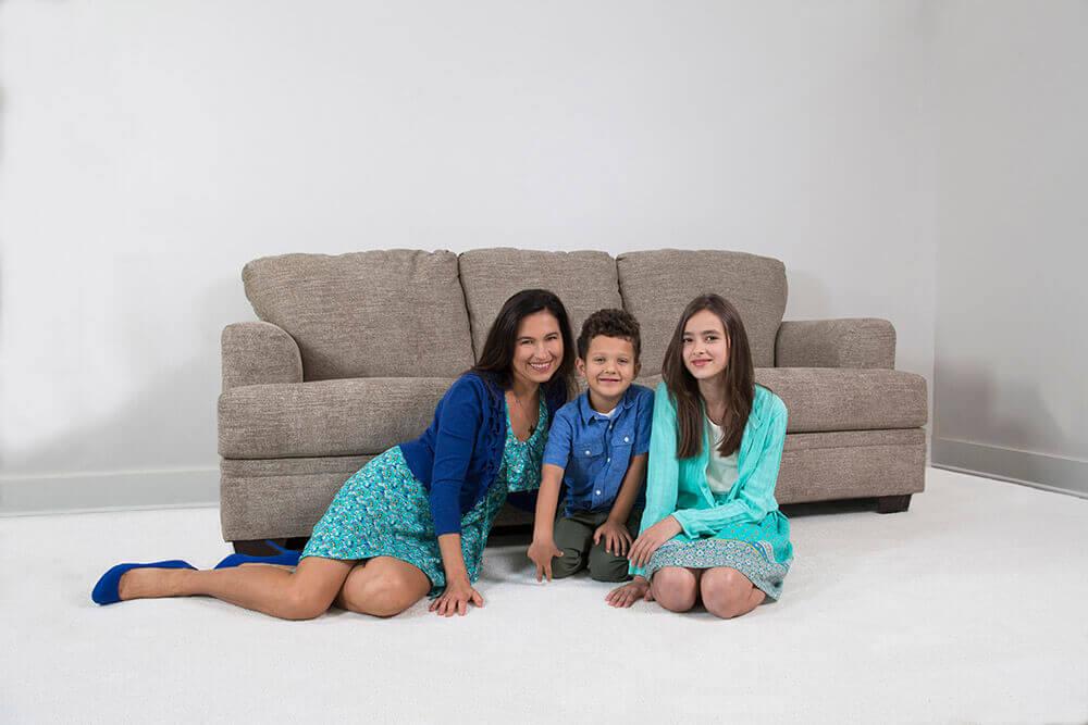 Family sitting on cleaned carpet
