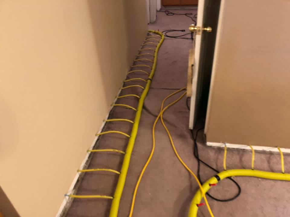 photo of our water extraction equipment at work after a winter flood in a Farmington home